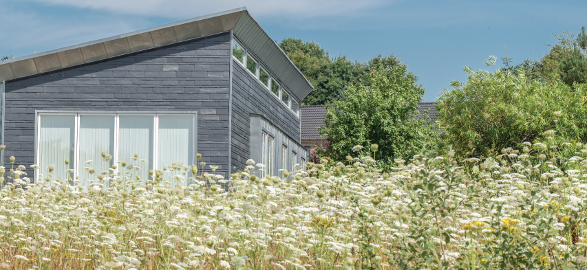 How slate tile is pioneering sustainable architecture for Sustainable siding